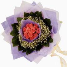 12 adet gül ve elyaflardan   Tunceli çiçek gönderme sitemiz güvenlidir