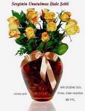 Tunceli çiçek gönderme  mika yada Cam vazoda 12 adet sari gül